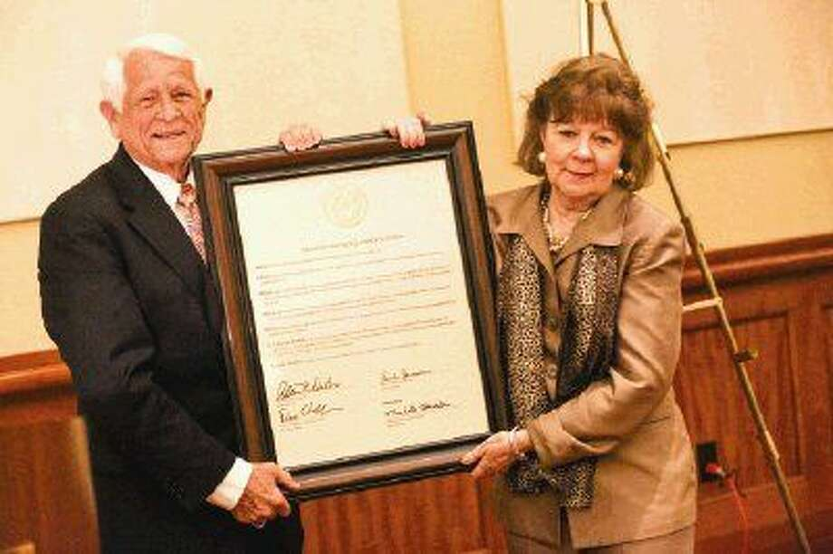 Judge Kathleen Hamilton, of the 359th state District Court, receives recognition from the State Bar of Texas, represented by President Allan DuBois, Friday at The Woodlands Waterway Marriott Hotel & Convention Center. Photo: Michael Minasi