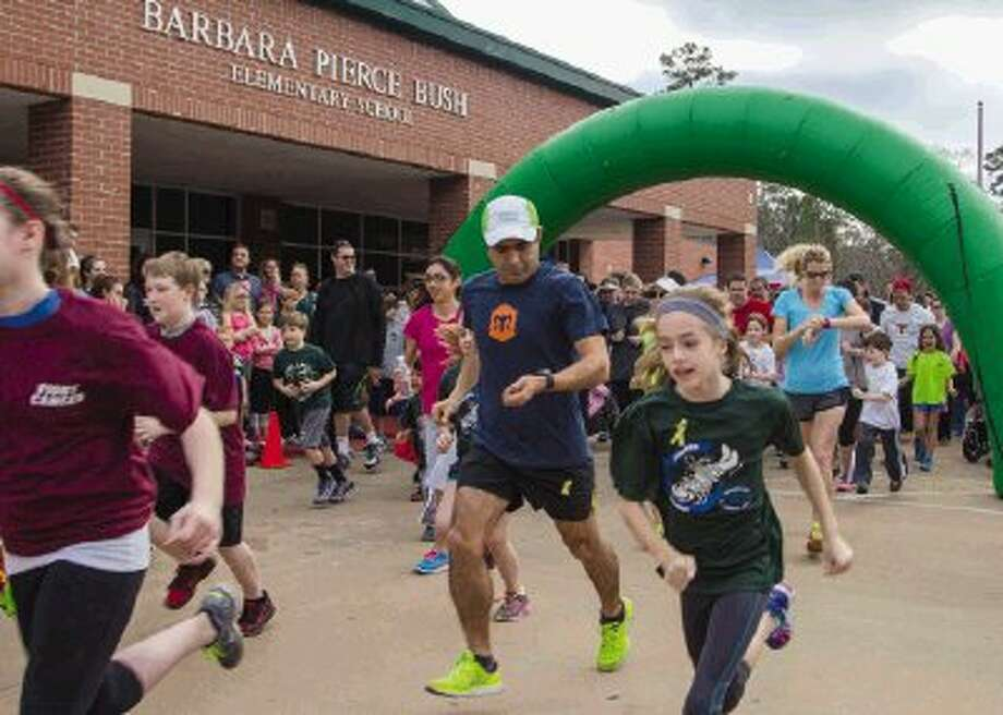 Runners, students and families participate in a fundraising 5K and one-mile run for Anjelica Beltran, a sixth grader at Cryar Intermediate School who is fighting Ewing's sarcoma, a rare bone cancer, at the Barbara Pierce Bush Elementary School in The Woodlands Sunday. Proceeds from the event will go toward Beltran's medical expenses and a car needed for transportation to and from the hospital. To view or purchase this photo and others like it, visit HCNpics.com. Photo: Staff Photo By Ana Ramirez / The Conroe Courier/ The Woodlands Villager