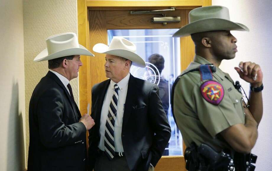 "Jackson County Sheriff A.J. ""Andy"" Louderback, left, confers with Chambers County Sheriff Brian Hawtohorne before giving testimony at a hearing Thursday in Austin. Photo: Eric Gay"