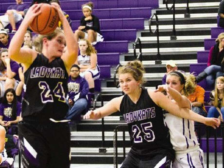 Willis' Calli Gray, left, and the Ladykats will face defending Class 4A state champion Georgetown in bi-district play on Monday night at Hearne High School. At right is Willis' Rene Schulze. Photo: Staff Photo By Ana Ramirez / The Conroe Courier/ The Woodland