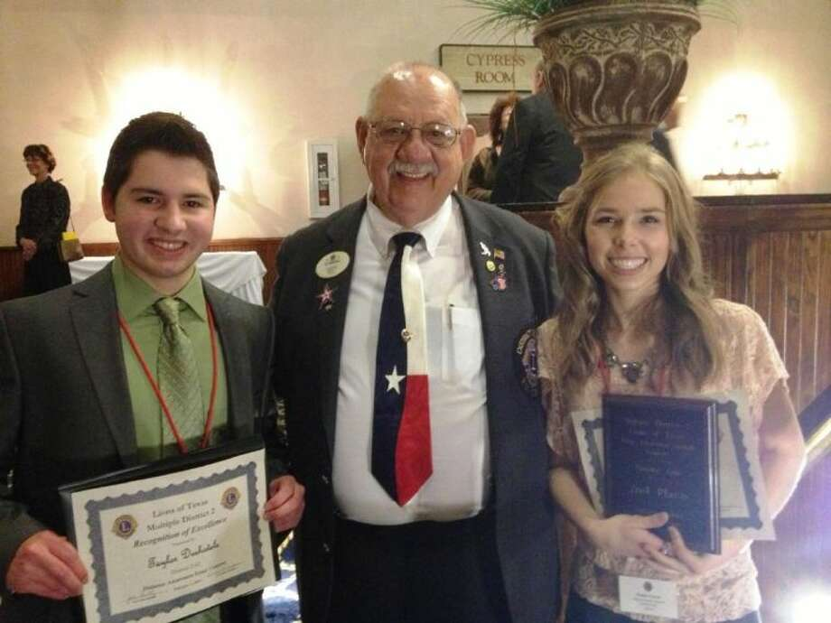 Conroe High seniors Taylor Deshotels, right, and Tanna Vayon, left, recently represented the Lions of District 2-S2 at the Lions State Youth Contest competitions in Kerrville. Congratulations to Tanna for taking second place. Also pictured is District Governor Eddie Risha, of Conroe Noon.