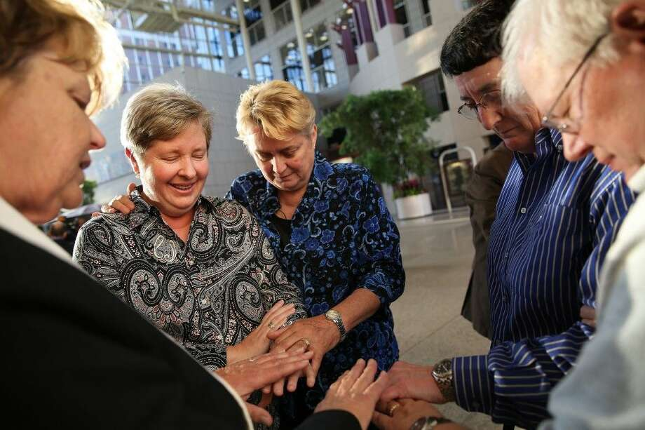 Kim Gebauer, left, and Regina Gebauer, both of Daphne, Ala., get married in a double wedding with Peggy Belcher, second from right, and her partner Louise Lynn, both of Mobile, Ala., on Thursday at Government Plaza in Mobile. The Rev. Sandy O'Steen of Mobile's Cornerstone Metropolitan Community Church officiated. Photo: Sharon Steinmann