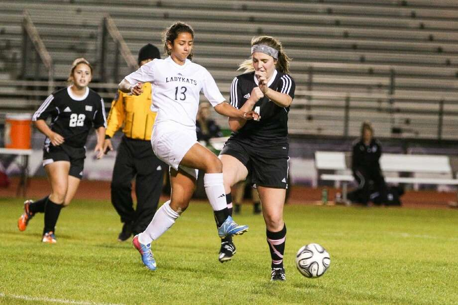 Willis' Crisely Pavon (13) battles for control of the ball with Conroe's Madison Weddel (4) during the high school girls soccer game on Tuesday, January 19, 2016, at Lynn Lucas Middle School. To view more photos from the game, go to HCNPics.com. Photo: Michael Minasi