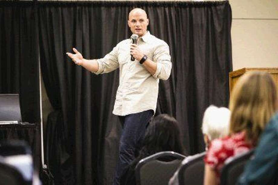 "Chip Wade, host of HGTV's ""Elbow Room,"" speaks during a seminar at the second annual Lake Conroe Home and Garden Show on Saturday at the Lone Star Convention and Expo Center. Photo: Michael Minasi"