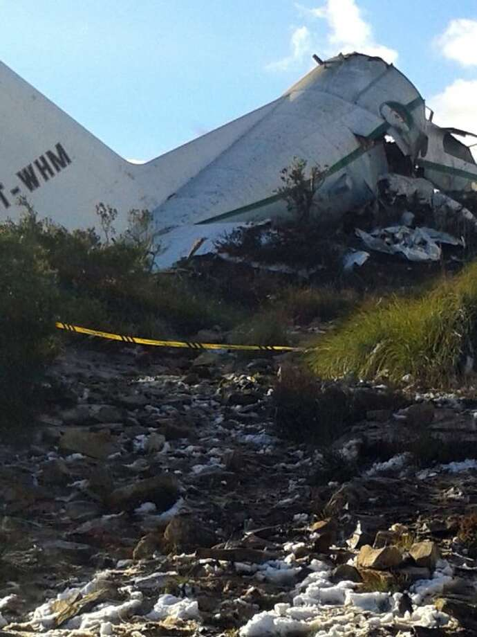 An Algerian military transport plane is pictured after it slammed into a mountain in the country's rugged eastern region Tuesday.