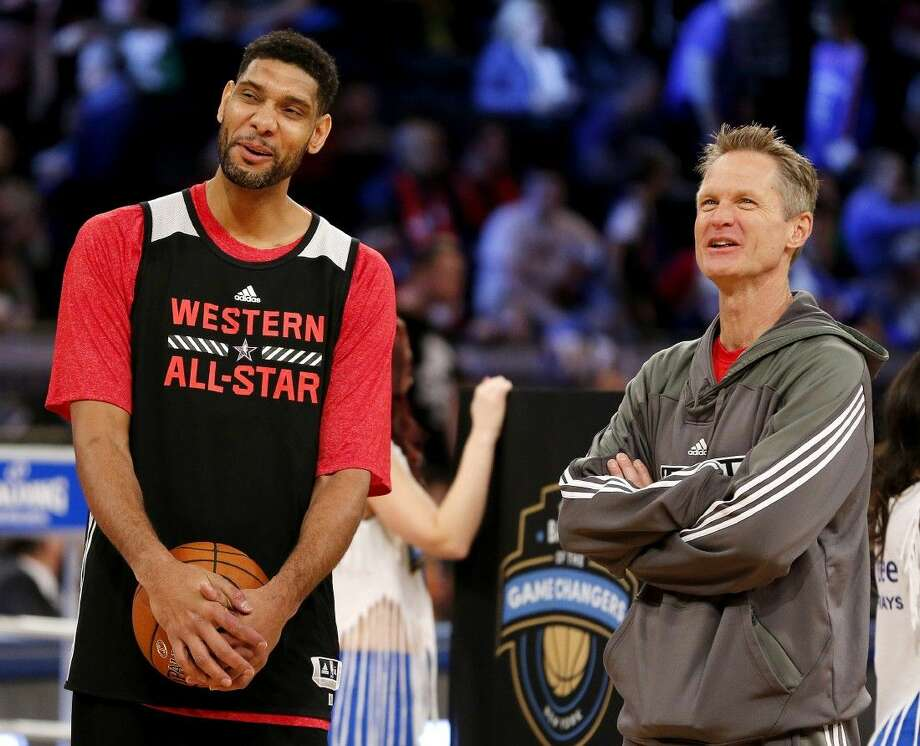 Tim Duncan of the Spurs, left, shares a laugh with West coach Steve Kerr before the NBA All-Star Game on Sunday night in New York. Photo: Julio Cortez