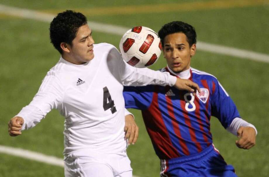 Conroe's Juan Ramirez controls the ball as Oak Ridge's Marcos Chavez defends during a District 14-5A match on Wednesday at Buddy Moorhead Memorial Stadium. To view or purchase this photo and others like it, visit HCNpics.com. Photo: Jason Fochtman