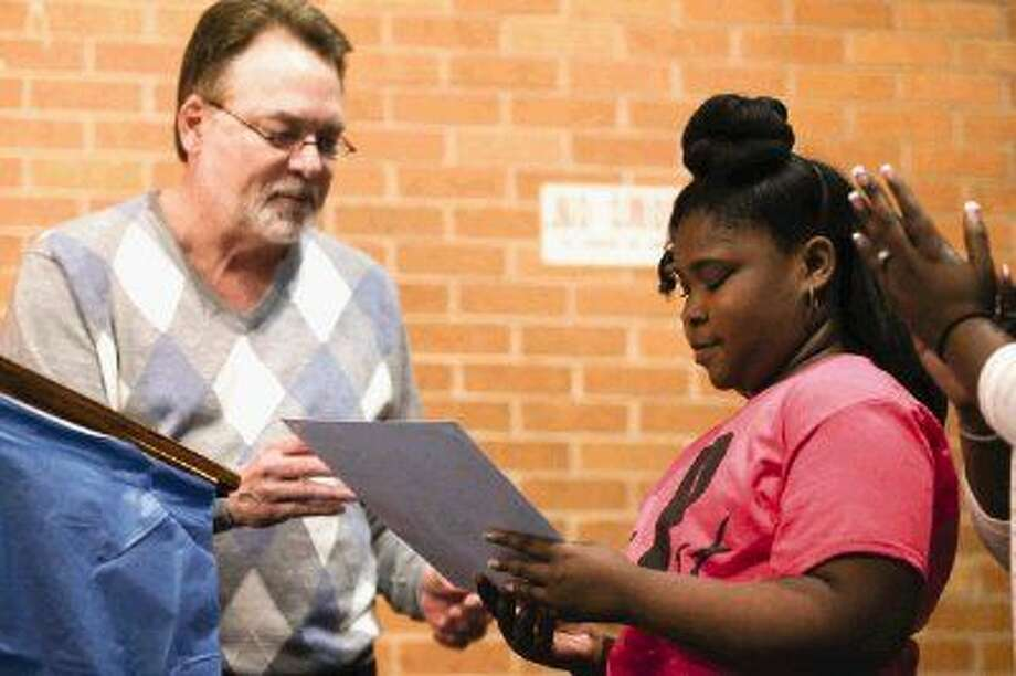 Conroe Mayor Pro Tem Guy Martin, left, gives a proclamation to Jada Johnson during the annual Black History Month Awards Ceremony Saturday in Conroe. Photo: Michael Minasi