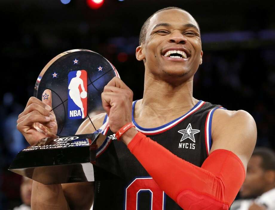 Russell Westbrook, of the Oklahoma City Thunder, holds the MVP trophy after Sunday night's NBA All-Star Game. Photo: Kathy Willens