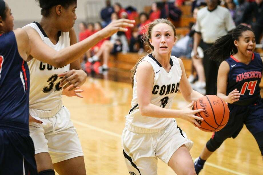 Conroe's Logan Magee (3) drives for the basket during the high school girls basketball game against Atascocita last week. Photo: Michael Minasi