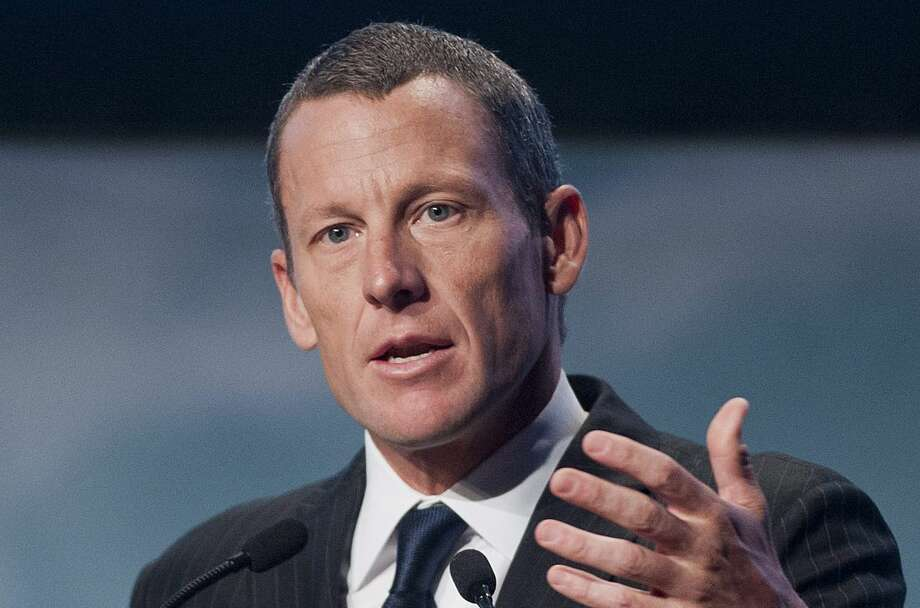 FILE - In this Aug. 29, 2012 file photo, Lance Armstrong speaks to delegates at the World Cancer Congress in Montreal. A three-man arbitration panel has ordered Armstrong and Tailwind Sports to pay $10 million in a fraud dispute with SCA Promotions, the promotions company announced Monday, Feb. 16, 2015. (AP Photo/The Canadian Press, Graham Hughes, File) Photo: Graham Hughes