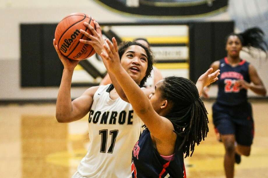 Conroe's Jznae Kim (12) goes for a layup during the high school girls basketball game against Atascocita on Tuesday, January 19, 2016, at Conroe High School. To view more photos from the game, go to HCNPics.com. Photo: Michael Minasi