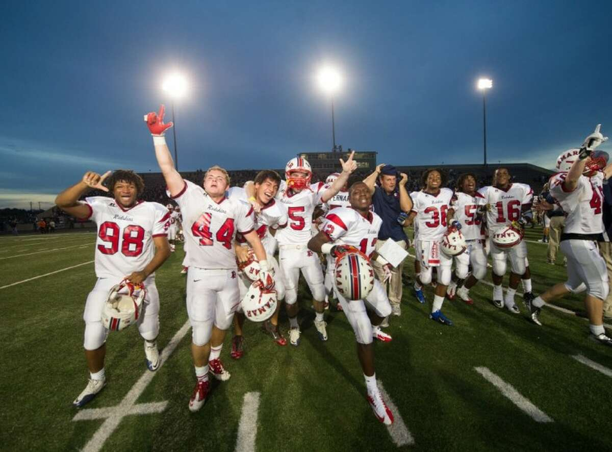 The Lamar Redskins celebrate their Division I state semifinal victory Saturday afternoon over San Antonio O'Connor in Austin. The Redskins are now 15-0 on the year and will play Allen 8 p.m. Saturday night in Arlington for the Division I 5A state championship.