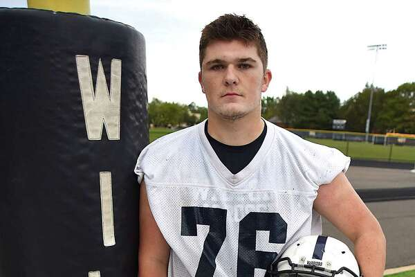 Colin Carroll, a two-way lineman and senior captain for the Wilton High football team, is following in his brother's footsteps as a Warrior player and captain.