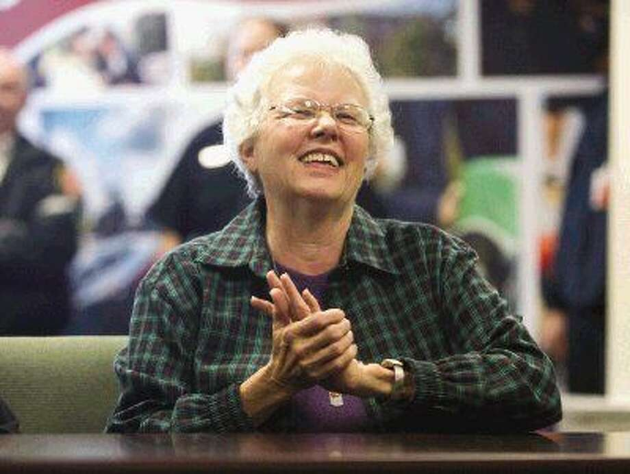 Arlene Lafitte smiles as a coworker recounts the story of helping save her life during a ceremony Tuesday at the Montgomery County Hospital District Administration Building in Conroe. The ceremony brought together coworkers and emergency personnel who helped save Lafitte's life after she went into cardiac arrest last year while working at Woodforest National Bank. Photo: Jason Fochtman