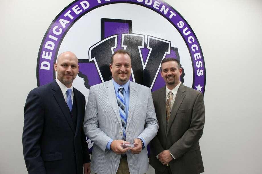Ken Labonski, center, receives the February MVP award from Willis ISD Superintendent Tim Harkrider, left, and Willis High School Principal Travis Utecht.