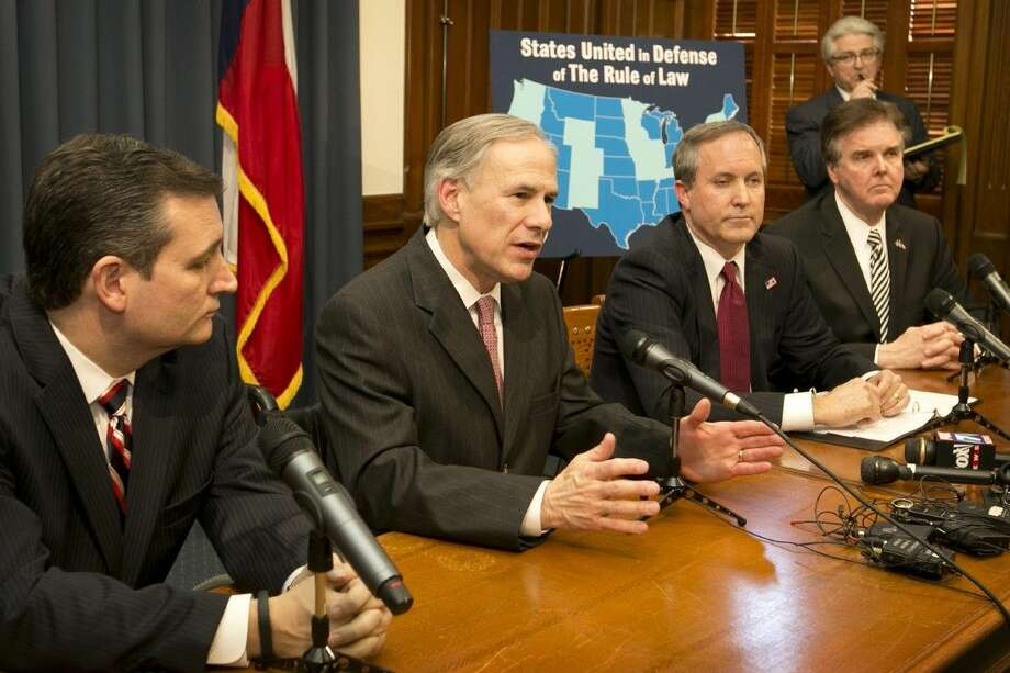 From left, Texas Sen. Ted Cruz, Gov. Greg Abbott, Attorney General Ken Paxton and Lt. Gov. Dan Patrick talk about President Obama's executive actions on immigration Wednesday in Austin. Photo: Jay Janner