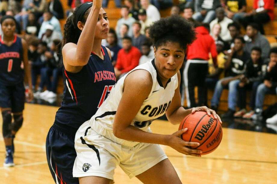 Conroe's Maya Grant (32) looks for an open teammate against Atascocita recently. Photo: Michael Minasi