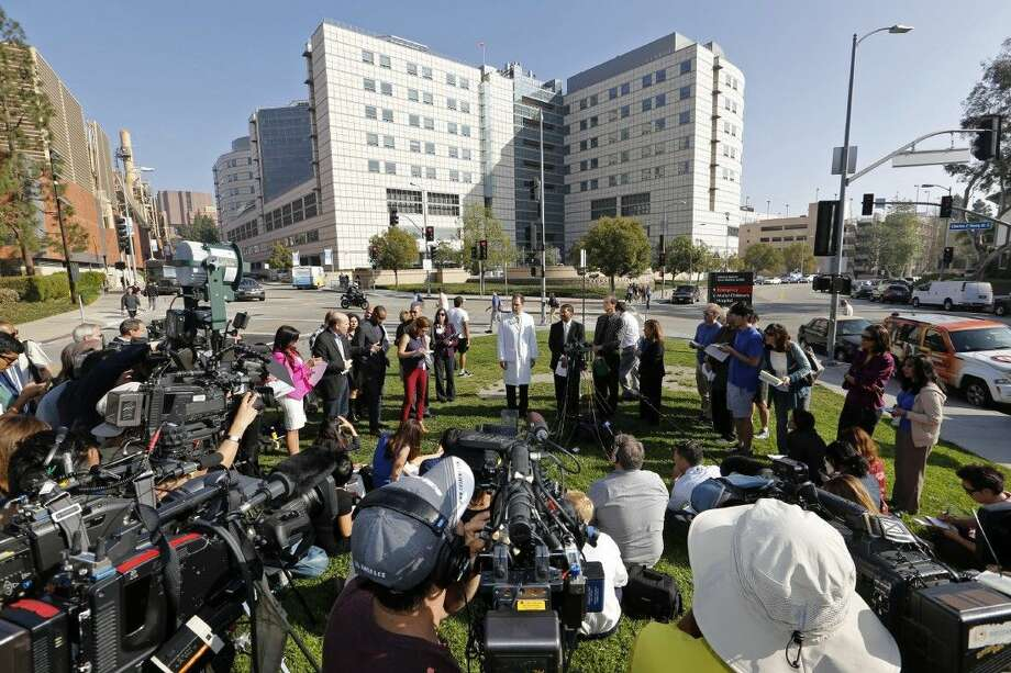 UCLA medical officials take questions from the media Thursday outside the Ronald Reagan UCLA Medical Center in Los Angeles. Photo: Damian Dovarganes