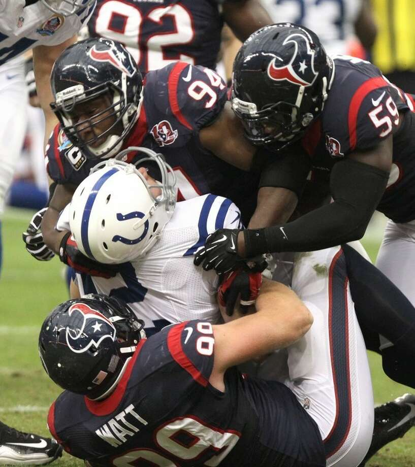 Houston Texans' J. J. Watt, Antonio Smith and Whitney Mercilus sack Indianapolis Colts' Andrew Luck during the Texans' 29-17 victory in 2012 at Reliant Stadium. Mercilus will start Sept. 14 at Oakland.