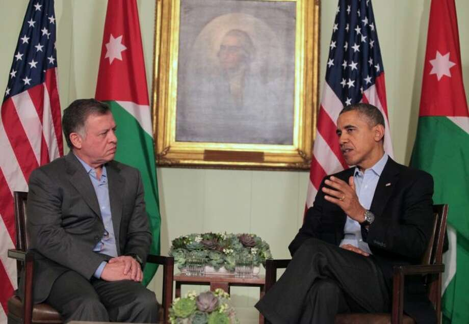 President Barack Obama sits with Jordan's King Abdullah II in a photo opportunity at the Sunnylands Estate in Rancho Mirage CA, Friday. The two leaders are holding talks this weekend on a range of subjects including the Middle East.