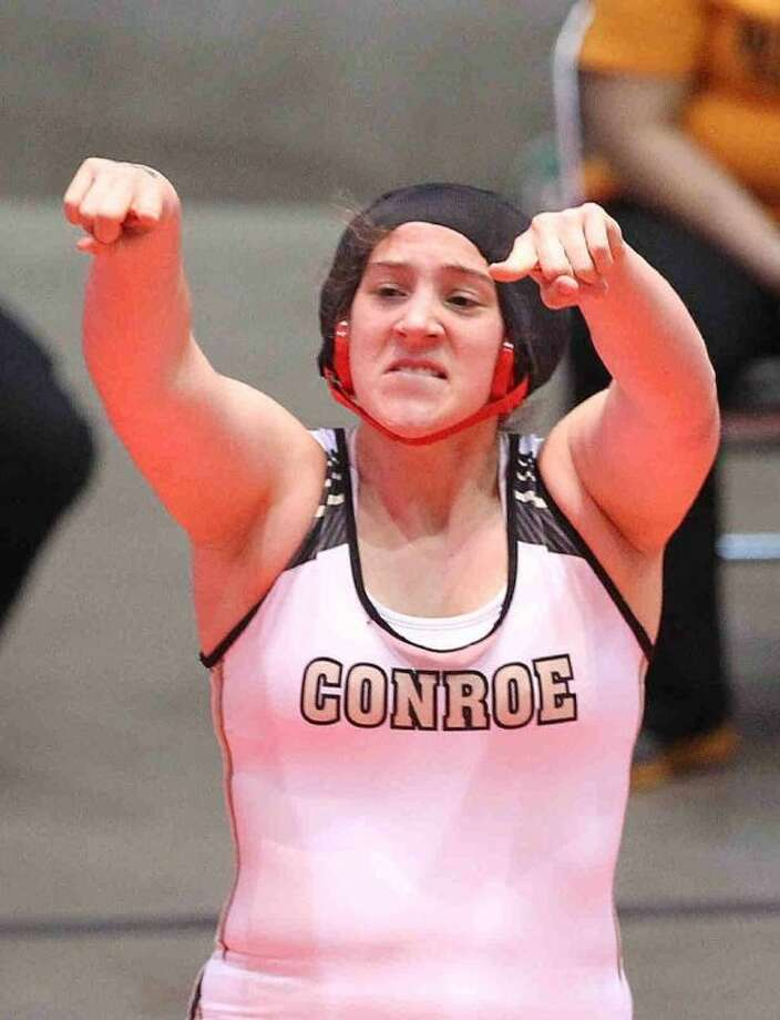 Conroe's Nicola Newton celebrates after winning the Class 5A 185-pound girls state title at the UIL State Wrestling Championship in Garland Saturday. To view or purchase this photo and others like it, visit HCNpics.com. Photo: Jason Fochtman