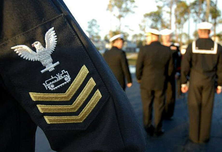 The sailor would be identified an Equipment Operator First Class under the system that the Navy will no longer use.