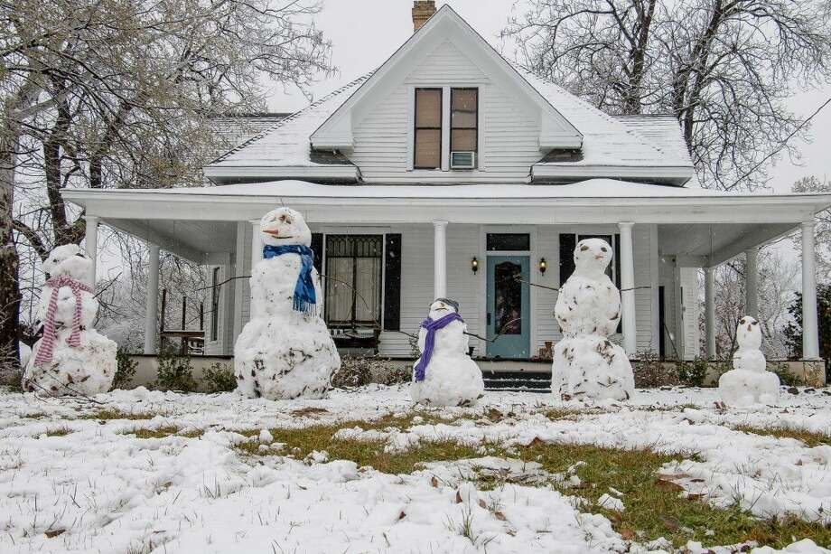 Snowmen on Wednesday line the front yard of a home on East Hubbard St. in Lindale. Photo: Clint Jones