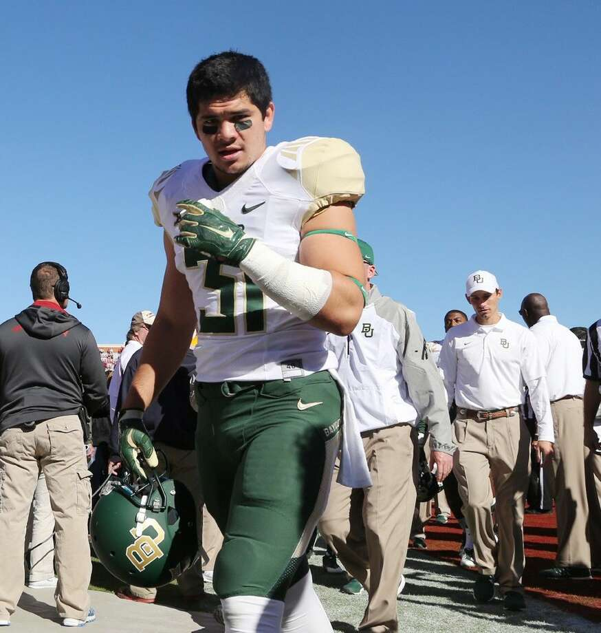 Baylor's Silas Nacita walks off the field after a game against Oklahoma in Norman, Okla. Baylor says running back Silas Nacita will no longer be part of the football program because of rules violations that affect his eligibility. Photo: Rod Aydelotte