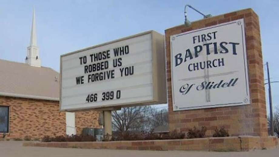 This photo from video provided by WFAA-TV in Dallas-Fort Worth shows a sign outside the First Baptist Church of Slidell in Slidell, Texas, forgiving the burglars who robbed the church last week. Pastor Bobby Cates last Friday, Feb. 14, 2014, found his church office ransacked and a laptop computer, other electronics and a sound system missing. A church van was stolen, but later recovered. / WFAA-TV