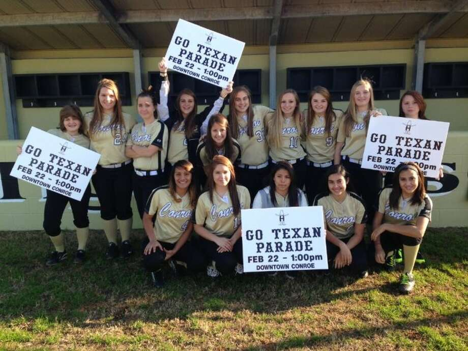 The Conroe Tigerette JV softball team helped to set up signs and notices in advance of Saturday's 49th Annual Go Texan Parade in downtown Conroe on Saturday.