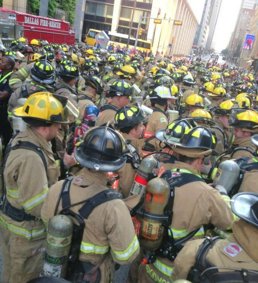 Firefighters - 343 in number - wore full gear and climbed the Renaissance Tower in Dallas. It is a 56-story building and participants in the Dallas 9/11 Memorial Stair Climb had to climb 55 floors twice during the event. Photo: Courtesy FBCSO