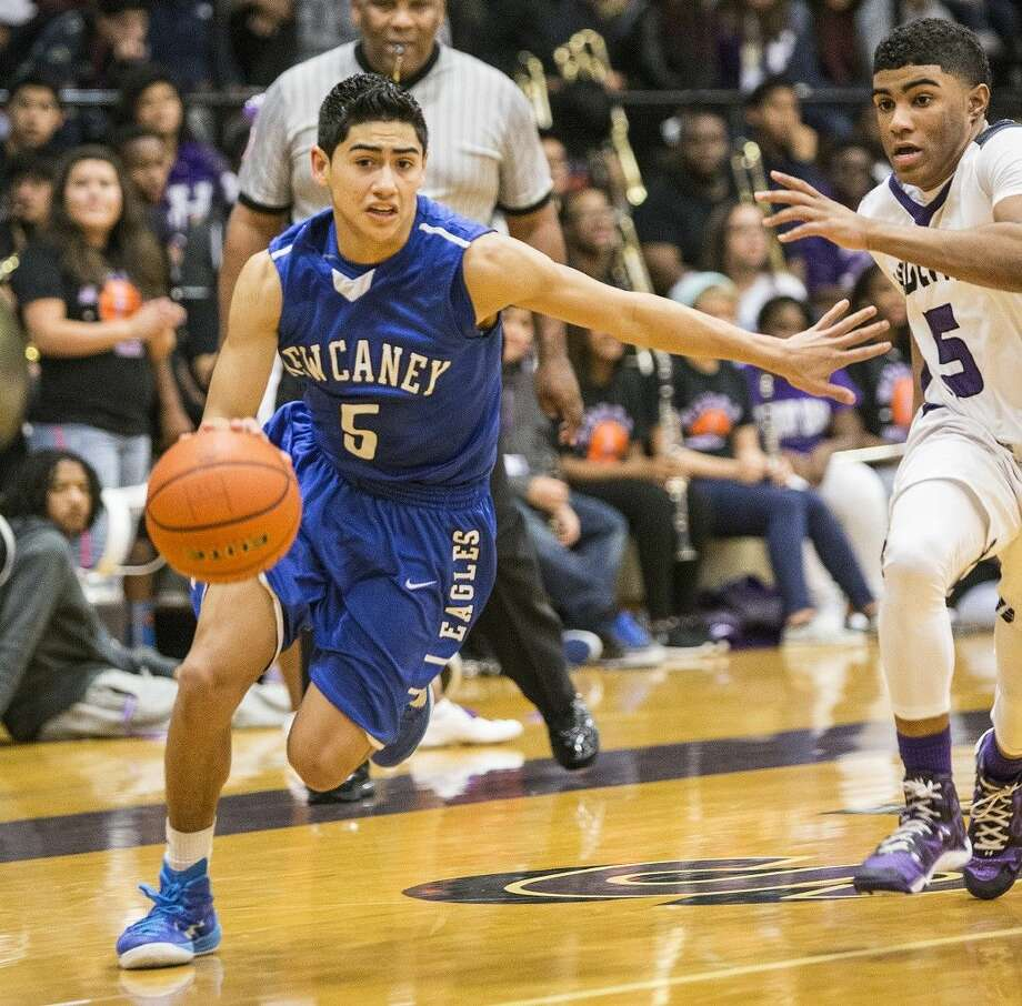 New Caney's Andrew Segovia (5) drives past a defender during Humble's 66-48 victory over New Caney to take first place in District 21-5A on Jan. 23, 2015, at Humble High School. Photo: ANDREW BUCKLEY