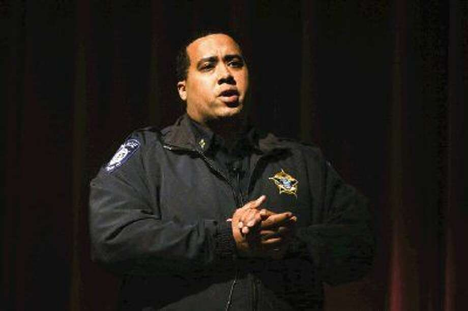Montgomery ISD Police Chief Brandon Torres speaks Monday during the parent meeting about drug use at Montgomery schools.