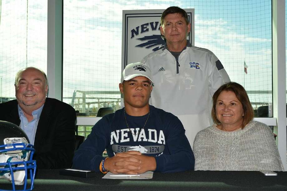 New Caney's David Harvey signed with Nevada for football on Wednesday.
