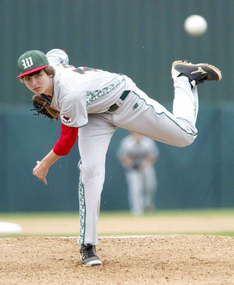 The Woodlands pitcher Steven Beard throws the ball against Richmond Foster. The Woodlands won 10-3.