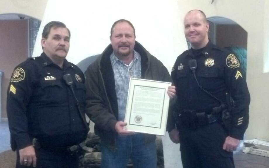 Conroe man honored for playing hero in deputy's time of need