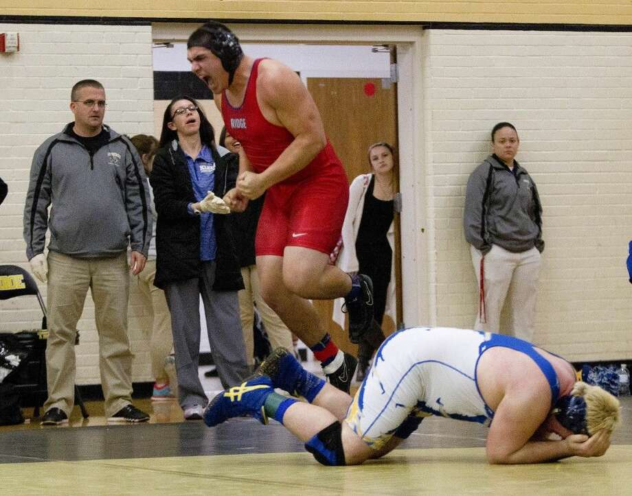 Oak Ridge Sergio Munoz celebrates after pinfalling Klein's Jordan Favela in the 1:43 minute mark in the first period to win the 285 lbs boys championship during the District 9-6A wrestling meet at Conroe High School Thursday. Photo: Jason Fochtman