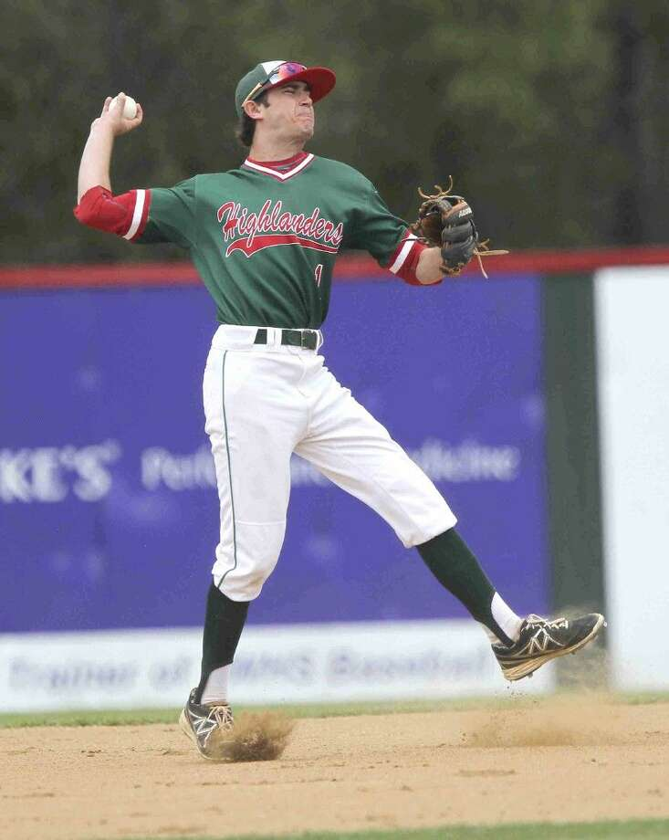 The Woodlands' Zach Gartner makes an off balance throw against Klein Oak Saturday. Photo: Jason Fochtman