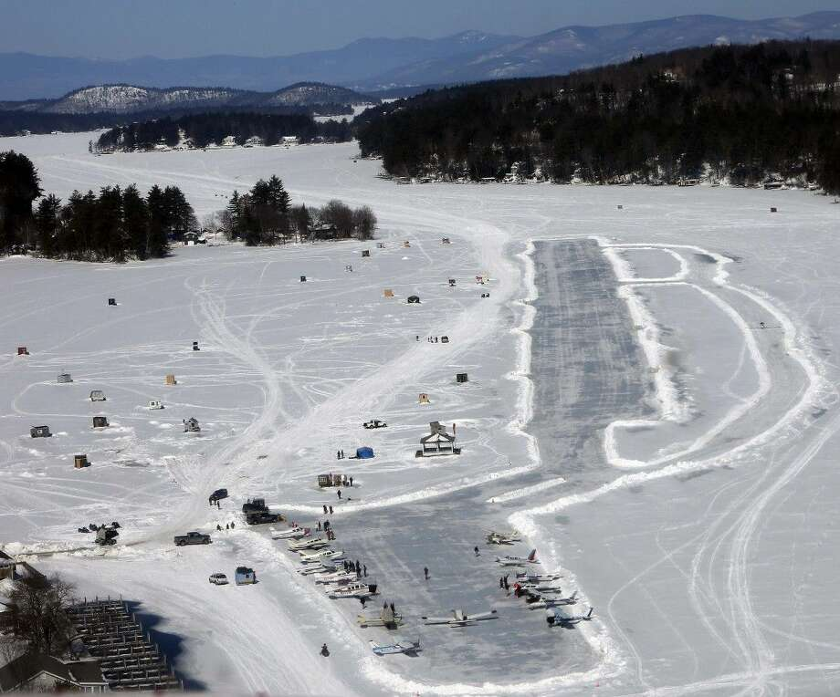 Planes parked on frozen Lake Winnipesaukee on Saturday in Alton, N.H. Dozens of pilots flew in to the only ice runway in the Lower 48 states approved by the Federal Aviation Administration. Photo: Jim Cole