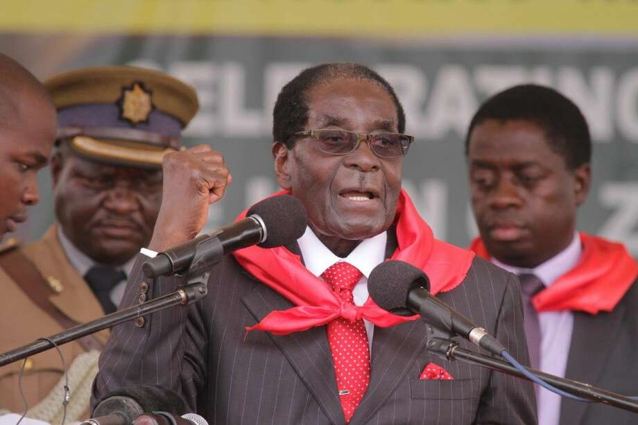 Zimbabwe President Robert Mugabe chants the party slogan during celebrations to mark his 91st birthday Saturday in the resort town of Victoria Falls.