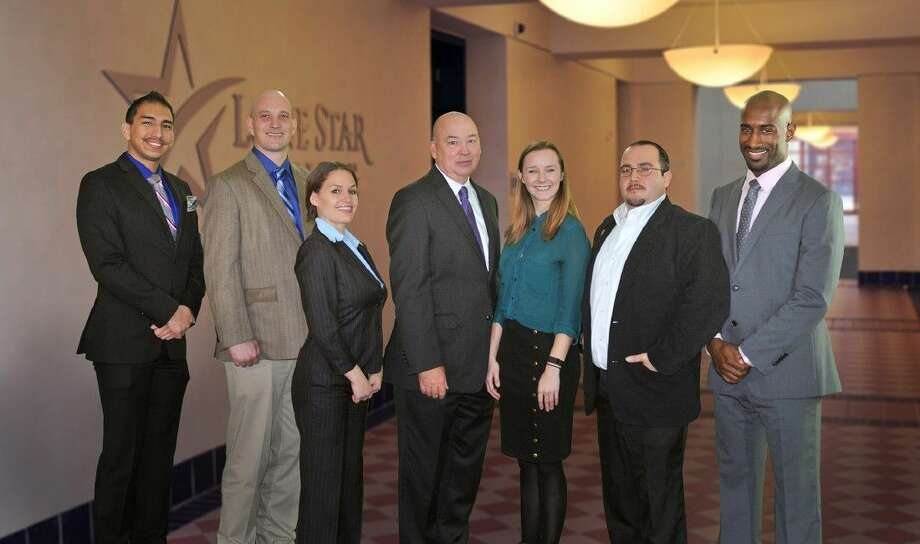Winners of the Lone Star College Foundation student essay contest with Dr. Stephen C. Head, LSC chancellor. Pictured left to right are: Jeremy Martinez, LSC-Montgomery; Gerald Hallford, LSC-Tomball; Krista Garrie, LSC-CyFair; Dr. Stephen C. Head, LSC chancellor; Ariana Velazco, LSC-Kingwood; Jesse Rodriquez, LSC-University Park; Eric Thompson, LSC-North Harris student.