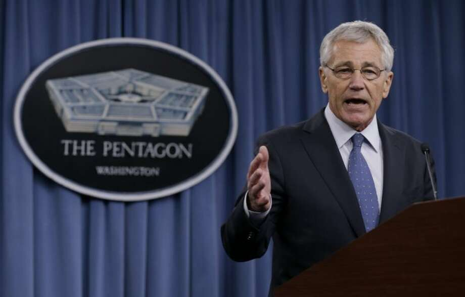 Defense Secretary Chuck Hagel briefs reporters at the Pentagon, Monday, Feb. 24, 2014, where he recommended shrinking the Army to its smallest size since the buildup to U.S. involvement in World War II in an effort to balance postwar defense needs with budget realities. Photo: Carolyn Kaster