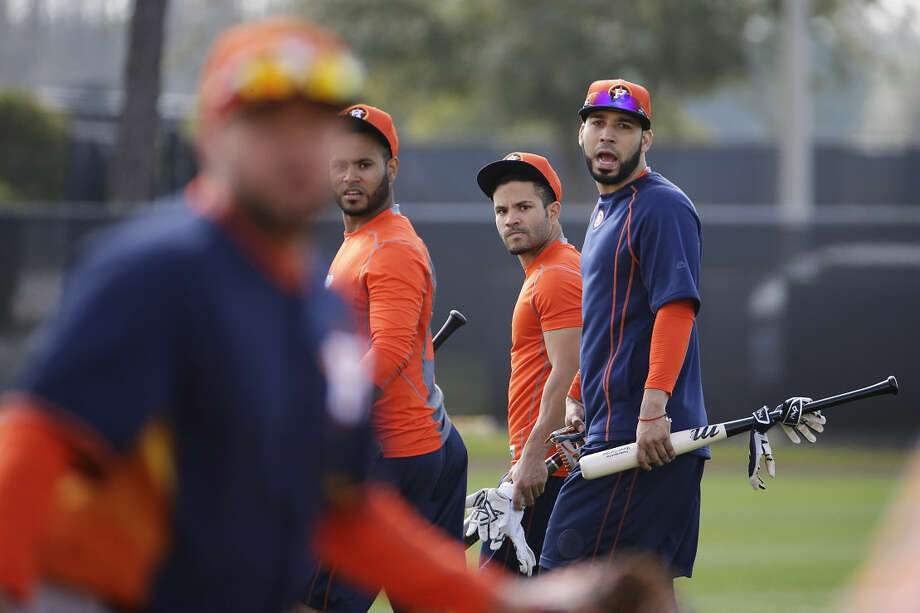 Houston Astros' Gregorio Petit, from left, Jose Altuve and Marwin Gonzalez walk on the field during a spring training baseball workout as Astros position players officially report today, Tuesday, Feb. 24, 2015, in Kissimmee, Fla. (AP Photo/David Goldman) Photo: David Goldman