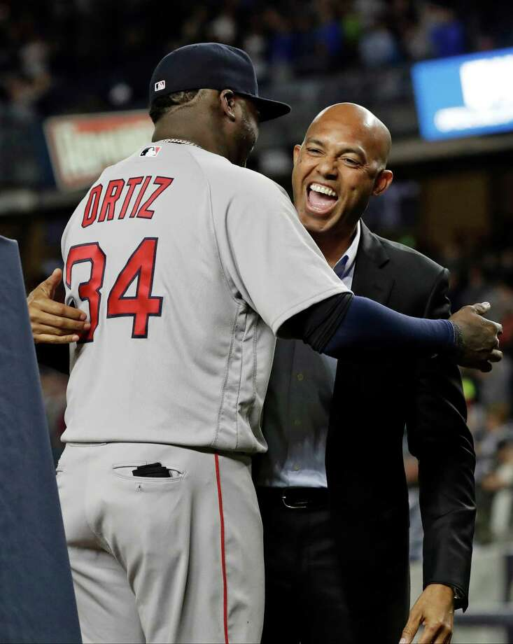 Boston Red Sox's David Ortiz is greeted by former New York Yankees pitcher Mariano Rivera as he is honored before Boston's baseball game against the Yankees on Thursday, Sept. 29, 2016, in New York. (AP Photo/Frank Franklin II) ORG XMIT: NYY201 Photo: Frank Franklin II / Copyright 2016 The Associated Press. All rights reserved.