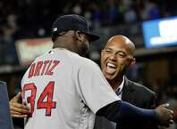 Boston Red Sox's David Ortiz is greeted by former New York Yankees pitcher Mariano Rivera as he is honored before Boston's baseball game against the Yankees on Thursday, Sept. 29, 2016, in New York. (AP Photo/Frank Franklin II) ORG XMIT: NYY201