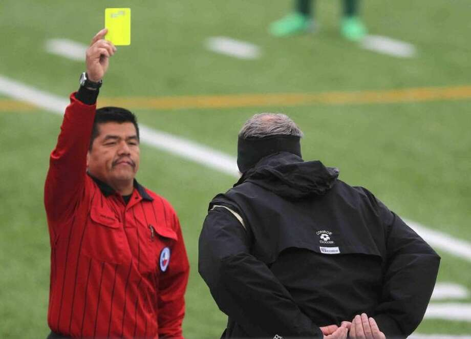 Conroe coach Jack Richburg receives a yellow card in the 63rd minute of a District 14-5A match against The Woodlands on Wednesday at Buddy Moorhead Memorial Stadium. The Highlanders won 2-1 on the strength of two second-half goals, the first of which came on a penalty kick. Photo: Jason Fochtman