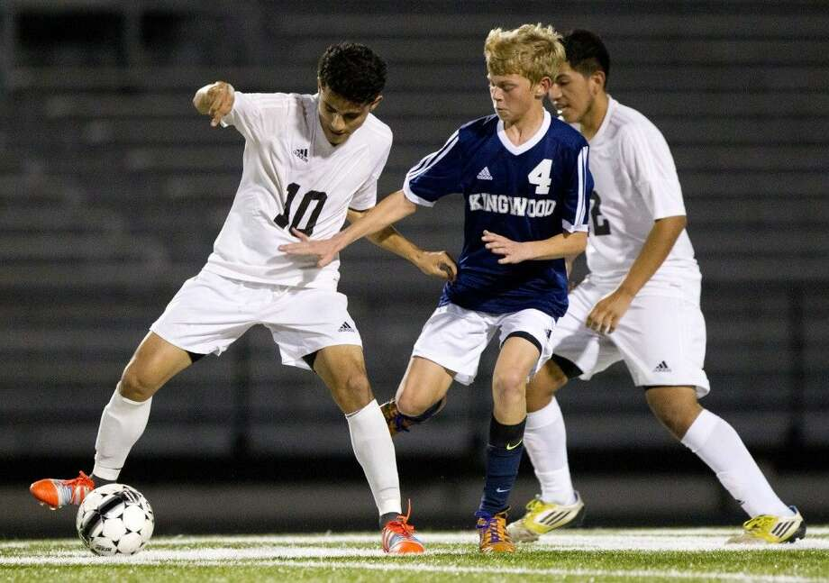 Conroe's Wilmer Burgos, left, and the Tigers are on the road to play Atascocita tonight. Photo: Jason Fochtman
