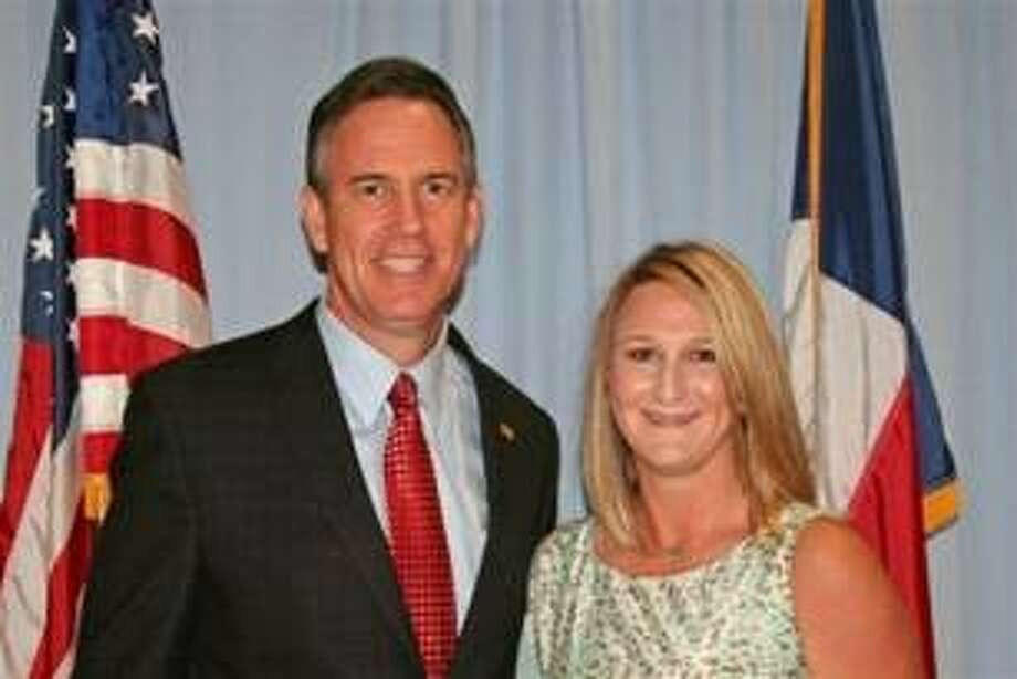 """Former Oak Ridge High School ag science teacher Kelly Sullivan poses with CISD Superintendent of Schools Don Stockton in 2012 after receiving the Texas State Teachers Association """"Secondary Teacher of the Year"""" award. Sullivan agreed with county prosecutors to permanently surrender her state teaching license earlier this week in lieu of avoiding prosecution for misdemeanor animal cruelty."""