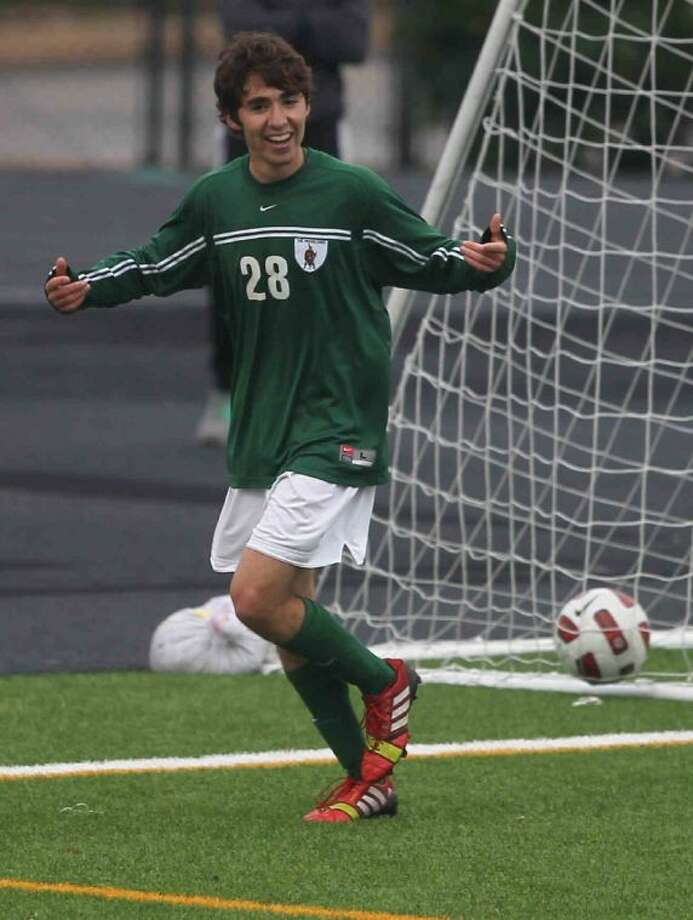 The Woodlands' Marcelo Tamez celebrates after scoring a goal during a District 14-5A match on Wednesday at Buddy Moorhead Memorial Stadium. To view or purchase this photo and others like it, visit HCNpics.com. Photo: Jason Fochtman